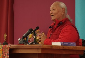 Chögyal Namkhai Norbu speaking at Dzamling Gar during the Teacher's Dagther Conference   Photo courtesy of Paula Barry