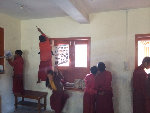 Monks preparing walls for painting