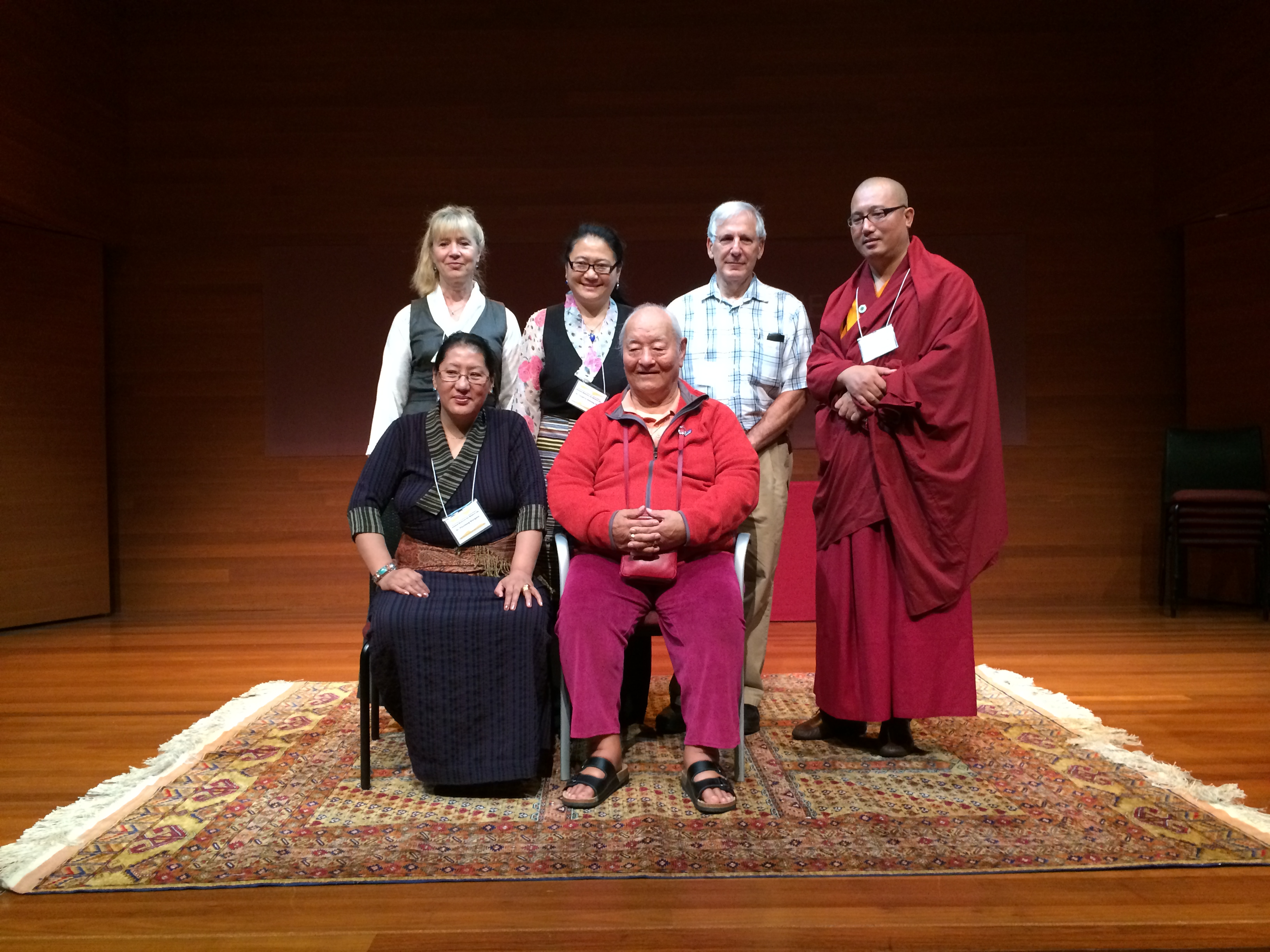 ATMA Board of Directors with Chögyal Namkhai Norbu. From left to right, Top row standing: Dr. Anasuya Weil, Dr. Kalzang Yangdron, Dr. Gerry Steinberg, Dr. Kunchok Gyaltsen Bottom row seated: Dr. Phuntsog Wangmo, Chögyal Namkhai Norbu