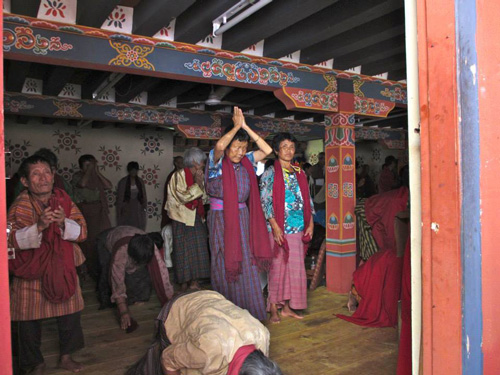 Prostrations at Chimed  Lhakhang. Photo by Maria Simmons