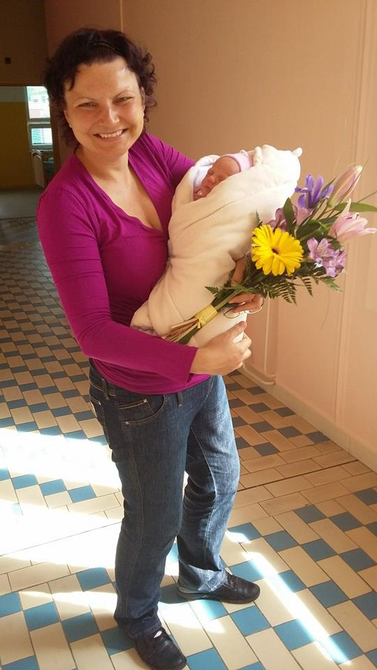 Happy Mother and Baby leaving hospital