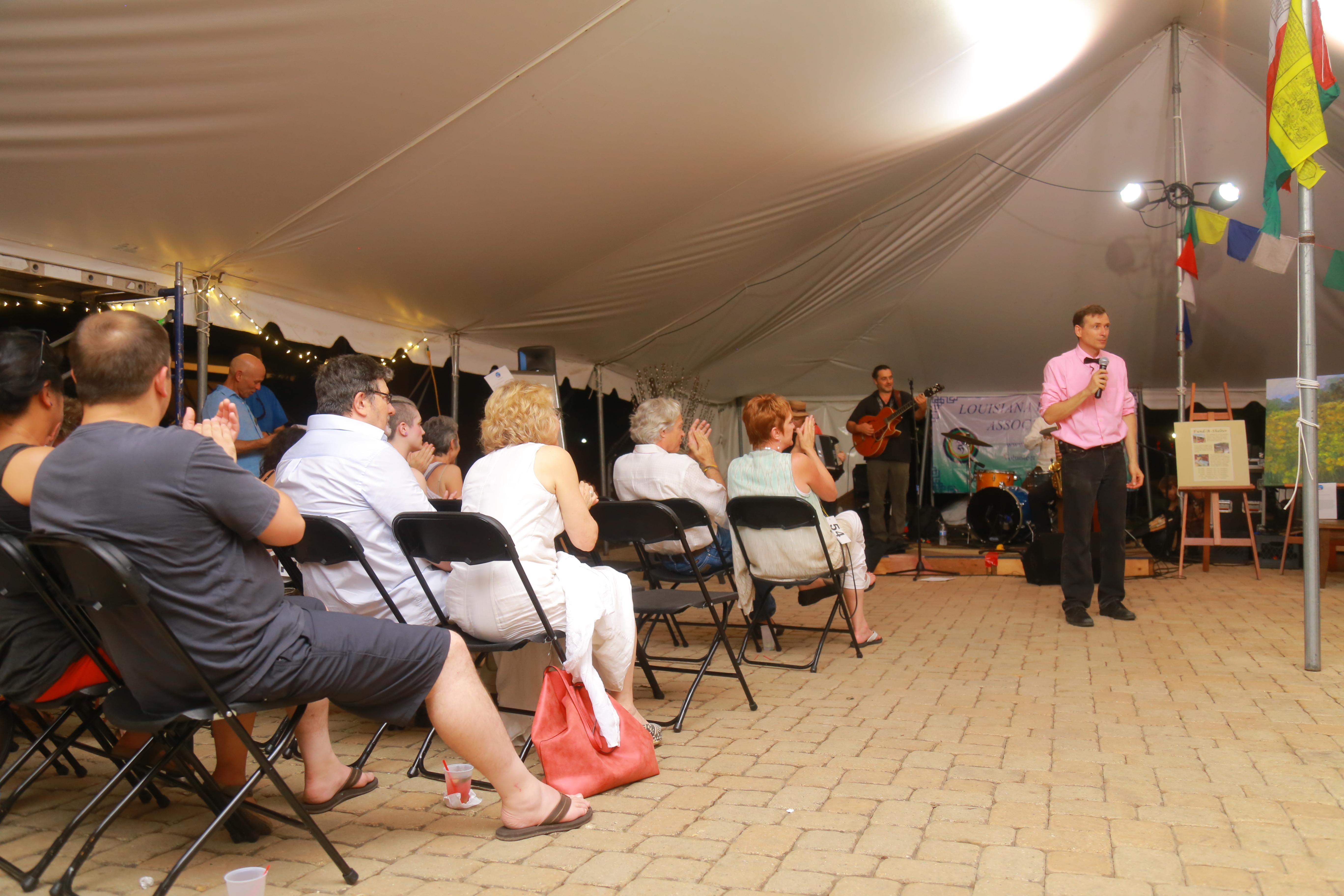John Calhoun, auctioneer extraordinaire at Full Circle LHA fundraiser