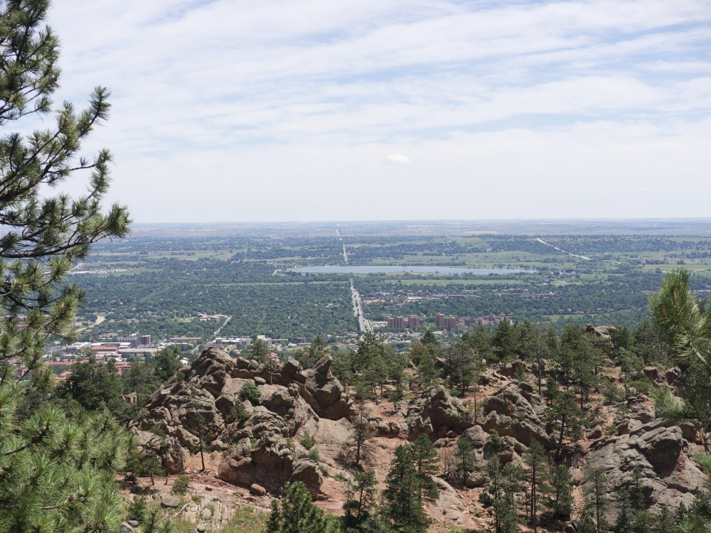 Scenic view of Boulder and Colorado University and view stretching to the east and Denver below - from Flagstaff Mountain high above Boulder: elevation 6000 ft above sea level