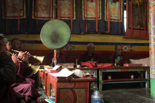 Kagyupa monks performing a puja praising Lord Naropa. Photo by Jamyang Oliphant