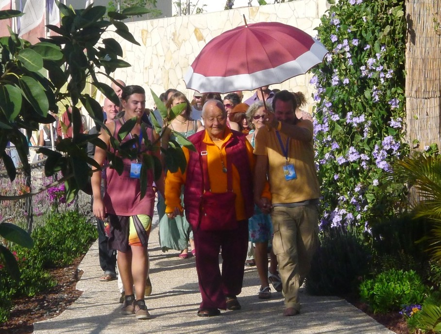 Rinpoche walks to the Gonpa for the Teachings