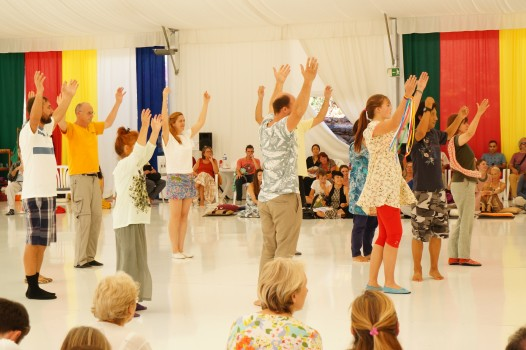 Teaching a dance to volunteers from the audience. Photo Mila Marchulenete