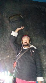 Cvetco pointing to Padmasambhava's footprint