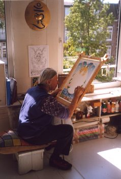 Ans painting in her studio in Amsterdam