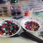 two bowls containing beads for evolution creations