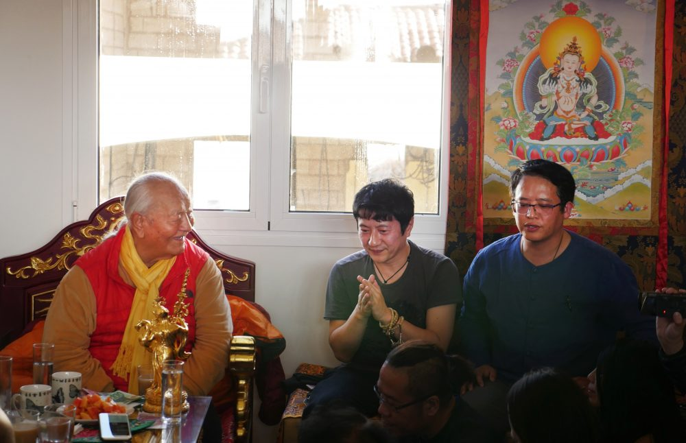 Zheng Jun (center) with Chögyal Namkhai Norbu at a gathering at the Samtengar House in Dzamling Gar