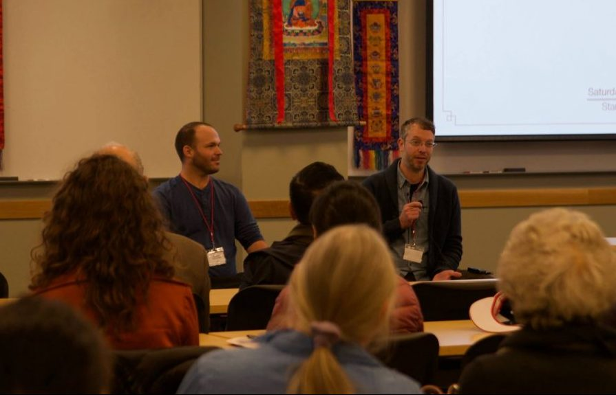 Matt Schmookler (left) and Luke Karamol presenting Yantra Yoga at the conference